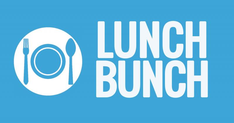 Blue background with white place setting that reads Lunch Bunch